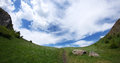 Mountain path to sky and heaven amazing landscape with walking trail in middle going in the cloudy Stock Photography