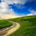 Mountain path uphill to the sky summer landscape through field turns Stock Images