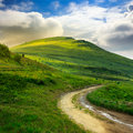 Mountain path uphill to the sky summer landscape through field turns Stock Photography