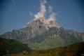 Mountain peak white clouds Royalty Free Stock Photo