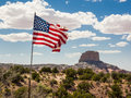 Mountain peak with flag in the foreground arizona us Royalty Free Stock Image