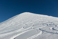 Mountain peak with fresh snow tracks in waveform Stock Photo