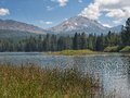 Mountain peak and lake lassen manzanita with surrounding forest at lassen volcanic national park california Stock Photo
