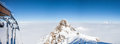 Mountain peak over the clouds in French Alps. Royalty Free Stock Photo