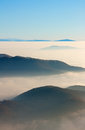 Mountain peaks above the clouds Royalty Free Stock Photography