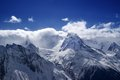 Mountain peaks in clouds caucasus dombay Stock Image