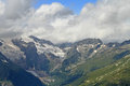 Mountain peaks in dombai summer cloudy weather Stock Image