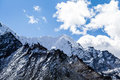 Mountain peaks in himalayas nepal beautiful nature mountains range landscape with snow and blue sky and clouds Stock Photography