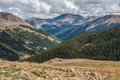 Mountain peaks from independence pass mountains and trees below cloudy skies on colorado Royalty Free Stock Photo