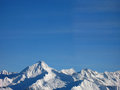 Mountain peaks in snow above a ski resort austria Stock Images