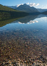 Mountain Reflects in the Mid Morning Light of Bowman Lake Royalty Free Stock Photo