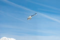 Mountain rescue emergency helicopter in flight, blue white Royalty Free Stock Photo