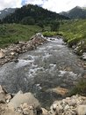 stock image of  Mountain river and alpine medow.