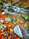 Mountain river with rapids and waterfalls at autumn time time Royalty Free Stock Photo