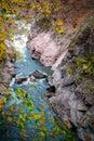 Mountain river among a stone canyon in autumn season Royalty Free Stock Photo