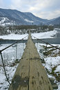 Mountain river suspension bridge across Royalty Free Stock Image