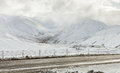 Mountain road on a cloudy winter day after snowfall south island new zealand Royalty Free Stock Photography