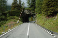 Mountain road and short tunnel in Alps in Switzerland Royalty Free Stock Photo