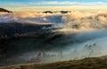 Mountain rural area in foggy autumn morning
