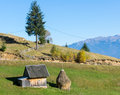 Mountain rural landscape with haystacks in autumn Royalty Free Stock Photo