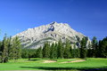 Mountain scene from the fairway a quiet hole on banff springs golf course makes for a tranquill moment for photographer Stock Photo