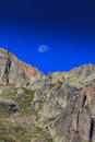 Mountain scenery in the french alps in summer with rocky cliffs blue sky and moonrise Royalty Free Stock Images