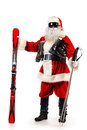 Mountain skier noel santa claus is standing in the ski mask and holding a skiing christmas isolated over white Royalty Free Stock Image