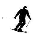 Mountain skier speeding down slope vector sport silhouette Stock Photos