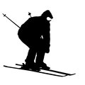 Mountain skier speeding down slope vector sport silhouette Stock Images