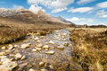 Mountain stream from beinn eighe rocky flows the range Royalty Free Stock Photography