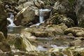 Mountain stream among the mossy stones Royalty Free Stock Photo