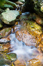 Mountain stream the through rocks Stock Photos
