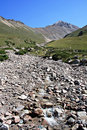 Mountain stream among stones and pebbles,Tien-Shan Royalty Free Stock Photography