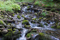 Mountain stream between stones water splashing stones Stock Images