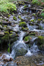 Mountain stream between stones water splashing stones Royalty Free Stock Images