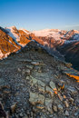 Mountain summit at sunrise a with alpenglow making the snowy glacier pink Stock Images