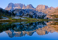 Mountain Sunrise Reflected in Alpine Lake. Royalty Free Stock Photo
