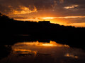Mountain sunset and river reflection Royalty Free Stock Photo