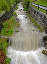 Mountain torrent confined by banks a in the valley of vilgraten eastern tyrol austria Royalty Free Stock Image