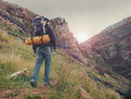 Mountain trekking man adventure hiking wilderness with backpack outdoor lifestyle survival vacation Stock Photos
