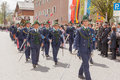 Mountain troops salute at the march in a parade with saber under dressed an elegant outfit Royalty Free Stock Images