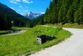 Mountain valley with a large stone path and peaks in the background Stock Photos