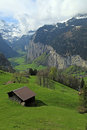 Mountain village in the alps switzerland beautiful traditional vertical image Stock Photography