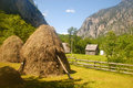 Mountain village and haystacks (Montenegro) Stock Photos