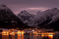 Mountain village night view of with snowy mountains Royalty Free Stock Photos