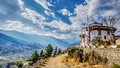 The Mountain Village with rural road on a Sunny Summer day. Royalty Free Stock Photo