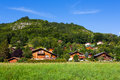 Mountain village wood houses placed on a hill Royalty Free Stock Images