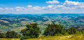 Mountain villages in the carpathian near coniferous forest and green meadows Royalty Free Stock Images