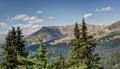 Mountain vista pine trees at crest of facing range Royalty Free Stock Image