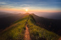 Mountain the way of climax slope have a way for walk background is sunset Stock Image